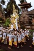 Indonesia, Bali, Gianyar, Pengastian ceremony, men carrying ceremonial tower to sea. (grainy) - Martin Westlake