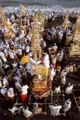 Indonesia, Bali, Gianyar, Pengastian ceremony, men place ceremonial towers on Lebih Beach. (grainy) - Martin Westlake