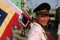 Vietnam, Ho Chi Minh City, Flag carrier at funeral procession. (grainy) - Martin Westlake