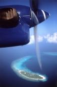 Maldives, Kunfunadhoo atoll, Soneva Fushi, flying over Maldives in seaplane. (grainy) - Martin Westlake