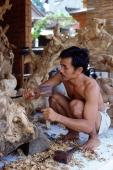 Indonesia, Bali, Ubud, Woodcarver at work. (grainy) - Martin Westlake