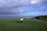 Indonesia, Bali, Tanah Lot, Putting out on 13th green Nirwana Bali Golf Club. (grainy) - Martin Westlake