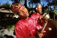 Indonesia, Bali, Kuta, Smiling gamelan players in hotel grounds. (grainy) - Martin Westlake