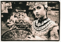 Indonesia, Bali, Gianyar, Legong dancer holding fan in temple grounds. ( artistic grain) - Martin Westlake