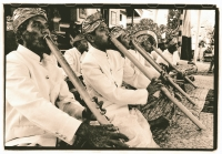 Indonesia, Bali, Gianyar, Bamboo flute players. (artistic grain) - Martin Westlake