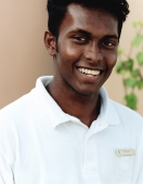 Maldives, Kuda Huraa atoll, Four Seasons Resort, Portrait of Indian Spa attendant. - Martin Westlake