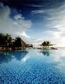 Maldives, Kuda Huraa atoll, Four Seasons Resort, Pool side. - Martin Westlake