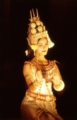 Cambodia, Angkor, Traditional Khmer dancer in full costume at Preah Khan Temple. - John McDermott
