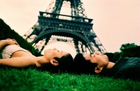 Young couple sleeping on grass, Eiffel Tower in background. (high-grained) - Leila  Pivetta