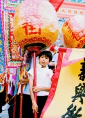 China, Hong Kong, Cheung Chau Island, Portrait of boy carrying a traditional lantern during the Bun Festival procession in 2000 - Carsten Schael
