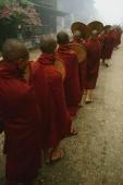 Myanmar (Burma), Bago, Line of Buddhist monks collecting alms. - Martin Westlake