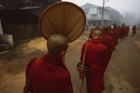 Myanmar (Burma), Bago, Buddhist monks line up to collect alms. - Martin Westlake