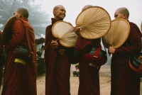 Myanmar (Burma), Bago, Smiling Buddhist monks with fans, collecting alms. - Martin Westlake