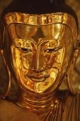 Myanmar (Burma), Shwedagon Paya, Yangon, Bronze Buddha statue. ( grainy) - Martin Westlake