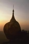 Myanmar (Burma), Kyaiktiyo, Worshippers at 'golden rock' at sunset. - Martin Westlake
