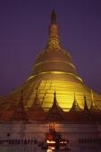 Myanmar (Burma), Bago, Worshippers at Shwemawdaw Paya at dusk. - Martin Westlake