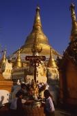 Myanmar (Burma), Yangon, Shwedagon Paya, Worshippers at Washing Buddha image at planetary post. - Martin Westlake