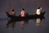 Myanmar (Burma), Pyay, Women crossing Irrawaddy river in a canoe. - Martin Westlake