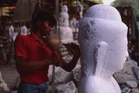Myanmar (Burma), Mandalay, Stone mason carving Buddha statue. - Martin Westlake