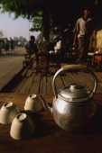 Myanmar (Burma), Pyay, Teapot and upturned cups at roadside teashop. - Martin Westlake