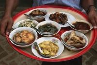 Myanmar (Burma), New Bagan, Selection of Burmese food on tray held by waiter. - Martin Westlake