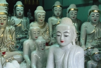 Myanmar (Burma), Mandalay, Marble Buddha statuettes on display in roadside stall. - Martin Westlake