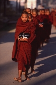 Myanmar (Burma), Nyaungshwe, Inle lake, Buddhist monks returning to monastery after collecting alms. - Martin Westlake