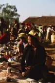 Myanmar (Burma), Inle lake, Pa-o woman selling groundnuts and beans at 5 day market. - Martin Westlake