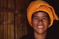 Myanmar (Burma), Near Kalaw, Pa-o woman in doorway of traditional house. - Martin Westlake