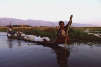 Myanmar (Burma), Inle lake, Women steering their laden canoe through backwaters. - Martin Westlake