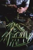 Myanmar (Burma), Nyaungshwe, Inle lake, Hand rolling cheroots at cheroot factory. - Martin Westlake