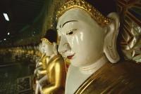 Myanmar (Burma), Sangaing Hills, Mandalay, Line of Buddha statues at Onhmin Thonze. - Martin Westlake