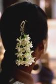 Myanmar (Burma), Pyay, Jasmine hair garland decorates woman's head. - Martin Westlake