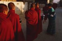 Myanmar (Burma), Inle lake, Buddhist monks receiving alms. - Martin Westlake