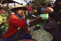 Myanmar (Burma), Sangaing, Woman selling beans at morning market. - Martin Westlake