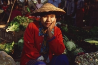 Myanmar (Burma), Sangaing, Vegetable seller at morning market. - Martin Westlake