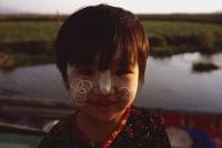 Myanmar (Burma), Inle lake, Girl with interesting bark patterns on her face. - Martin Westlake