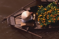 Vietnam, Can Tho, Hau river, Flower seller - floating market. - Martin Westlake