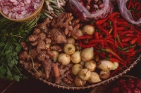 Vietnam, Cai Be, Mekong Delta, Vegetables and spices for sale. - Martin Westlake