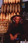 Vietnam, Ho Chi Minh city, Baguettes for sale at roadside stall. - Martin Westlake