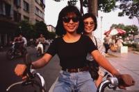 Vietnam, Ho Chi Minh city, Teenage girls on moped. - Martin Westlake