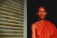 Vietnam, Trang Vinh Pagoda, Khmer Buddhist monk in pagoda doorway. - Martin Westlake