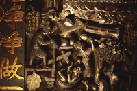 Vietnam, Ho Chi Minh city, Emperor of Jade Pagoda, Carvings on wall depicting hell. - Martin Westlake