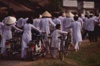 Vietnam, Tay Ninh, Caodist devotees returning home after funeral. - Martin Westlake