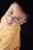 Boy smiling, portrait - Mary Grace Long