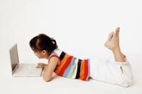 Girl using laptop on floor. - Erik Soh