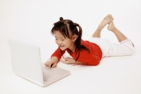 Girl on the floor using laptop. - Erik Soh