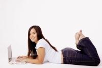 Young woman with laptop. - Erik Soh