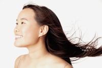 Profile of young woman, smiling - Erik Soh