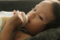 Toddler drinking milk from a bottle - Erik Soh